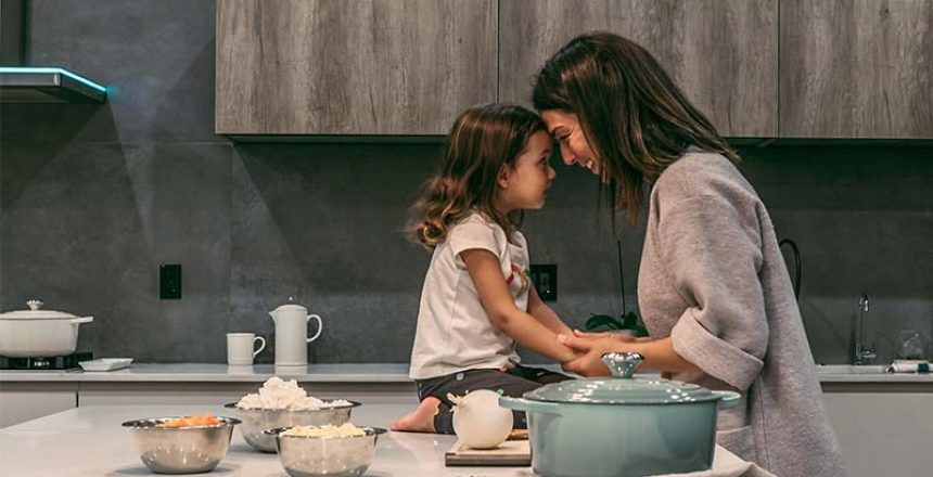 mother and daughter connecting in the kitchen